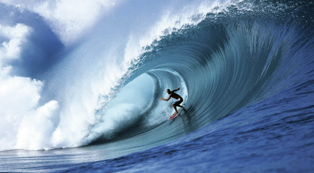 Professional surfer Shane Dorian catches a perfect wave in Teahupoo, Tahiti