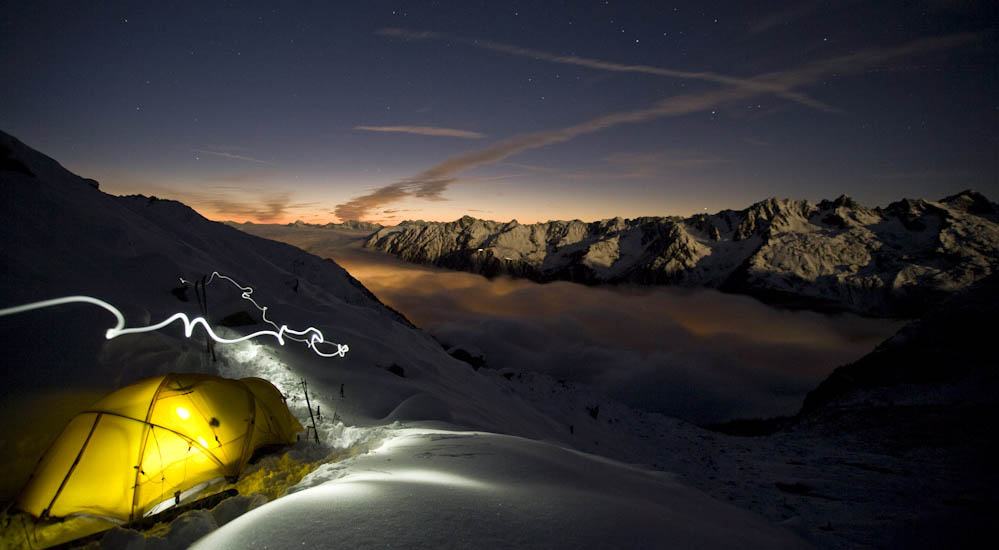 Morgan Sahlen paints with light at basecamp on Glacier des drus high above Chamonix, France